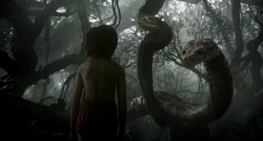 "Mowgli (newcomer Neel Sethi) meets Kaa (voice of Scarlett Johansson) in ""The Jungle Book,"" an all-new live-action epic adventure about Mowgli, a man-cub raised in the jungle by a family of wolves, who embarks on a captivating journey of self-discovery when he's forced to abandon the only home he's ever known. In theaters April 15, 2016. ©2015 Disney Enterprises, Inc. All Rights Reserved."